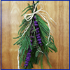 Evergreen swag with purple beautyberry on a door