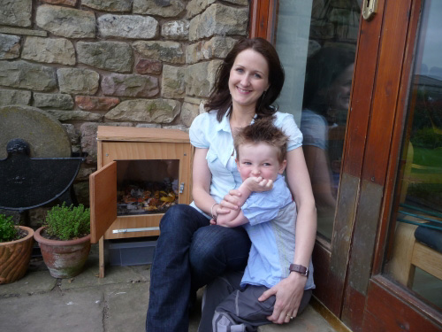 Susie and her son Tom with their new wormery.