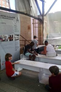 Interactive art. Kids of all ages take time out to add to a Lego construction project along the High Line.