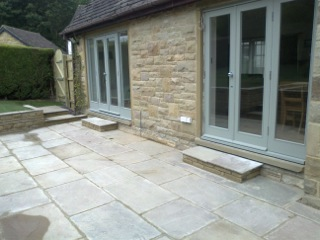 Natural paving and stone walls in an Ilkley garden
