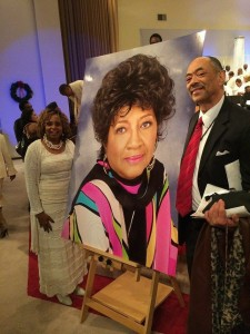 Rev. Bobby and Bri with photo of Rev. Dr. Johnnie Colemon