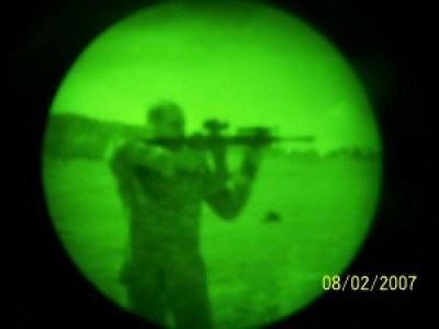 Me aiming M-4 in night vision
