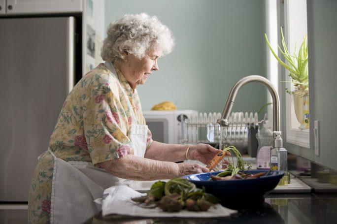 grandmother washing vegetables
