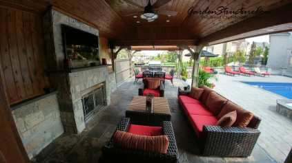 An open air living room with fireplace-- Great Cabana Design