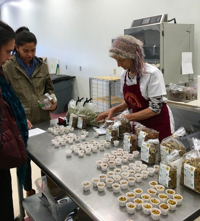 "Kamala Mars, proprieter of ""Kamala's Krunchies"" in the Taos Food Center. Photo by Elizabeth Hoover"
