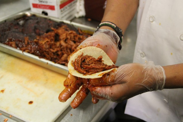 Chef Franco Lee preparing tacos from churro sheep meat tacos
