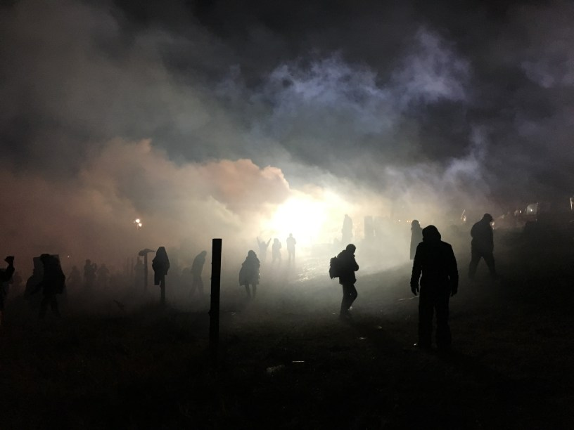 tear gas, launched at water protectors. photo by Elizabeth Hoover