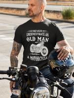 potiskana majica never underestimate an old man with a motorcycle motoristi moški moto cesta vožnja prosti čas smešno zabavno biker tiskarna garderoba spletno nakupovanje dostava po pošti osebni prevzem kvalitetne majice obstojen tisk udobno trgovina ljubljana