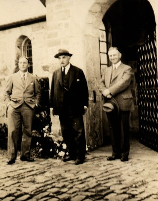 Gari Melchers (center) and studio architect, John Donaldson (left) in front of studio gate, ca. 1920s.