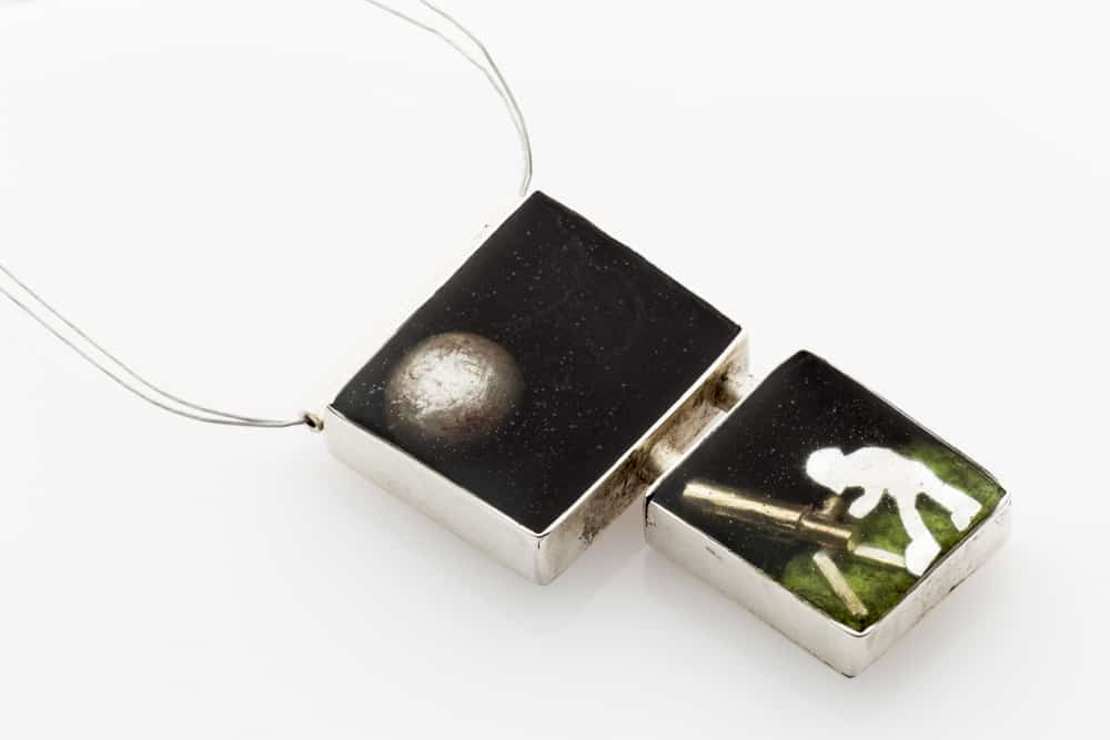 Amelina Trainor, Moongazer, Sterling Silver, brass, polymer clay, polyester resin, 2.5 cm width x 3cm height x .5 cm depth, made in Brisbane, photo: Lisa Brown