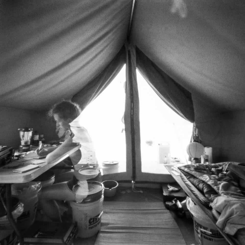 April Surgent, Self-portrait in personal tent