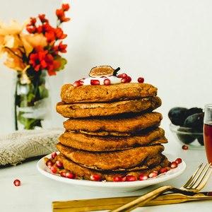 stack of fluffy orange vegan pancakes