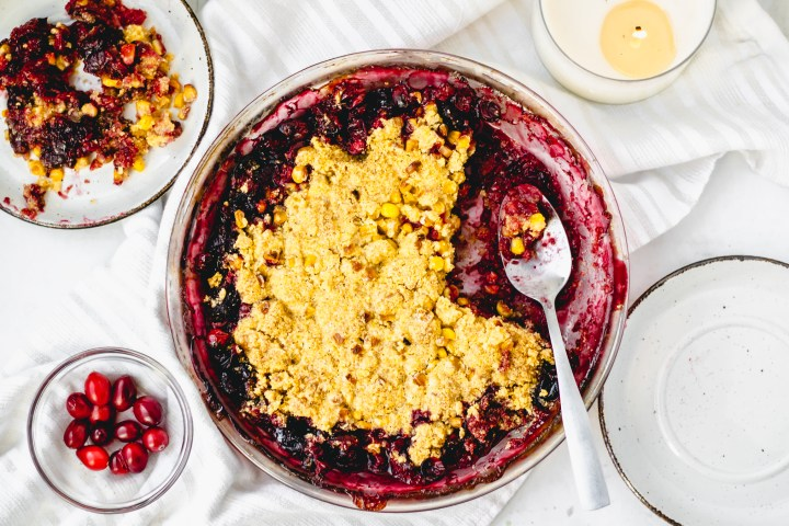This Cranberry Sweet Corn Crisp is a mashup of your perfect Thanksgiving leftovers! A cornbread-inspired topping makes this vegan dessert so festive.