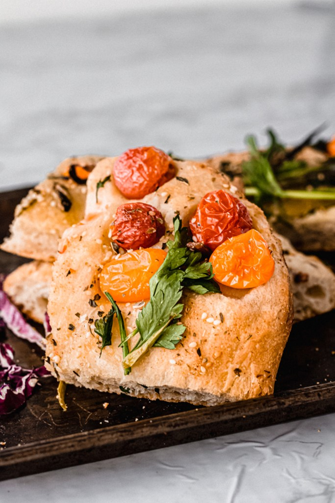 slice of focaccia with cherry tomatoes