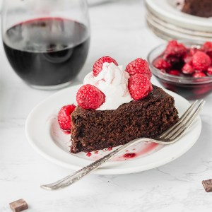 slice of vegan red wine chocolate cake with a silver fork