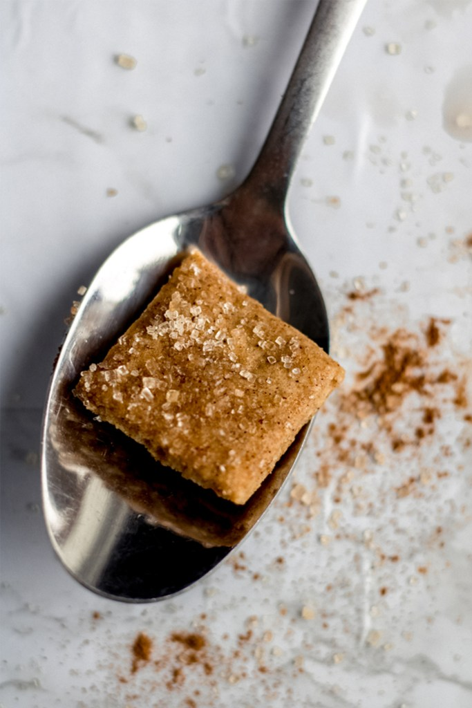 one cinnamon toast crunch square on a spoon
