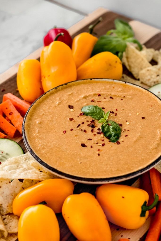 side view of a vegan peanut sauce with fresh veggies