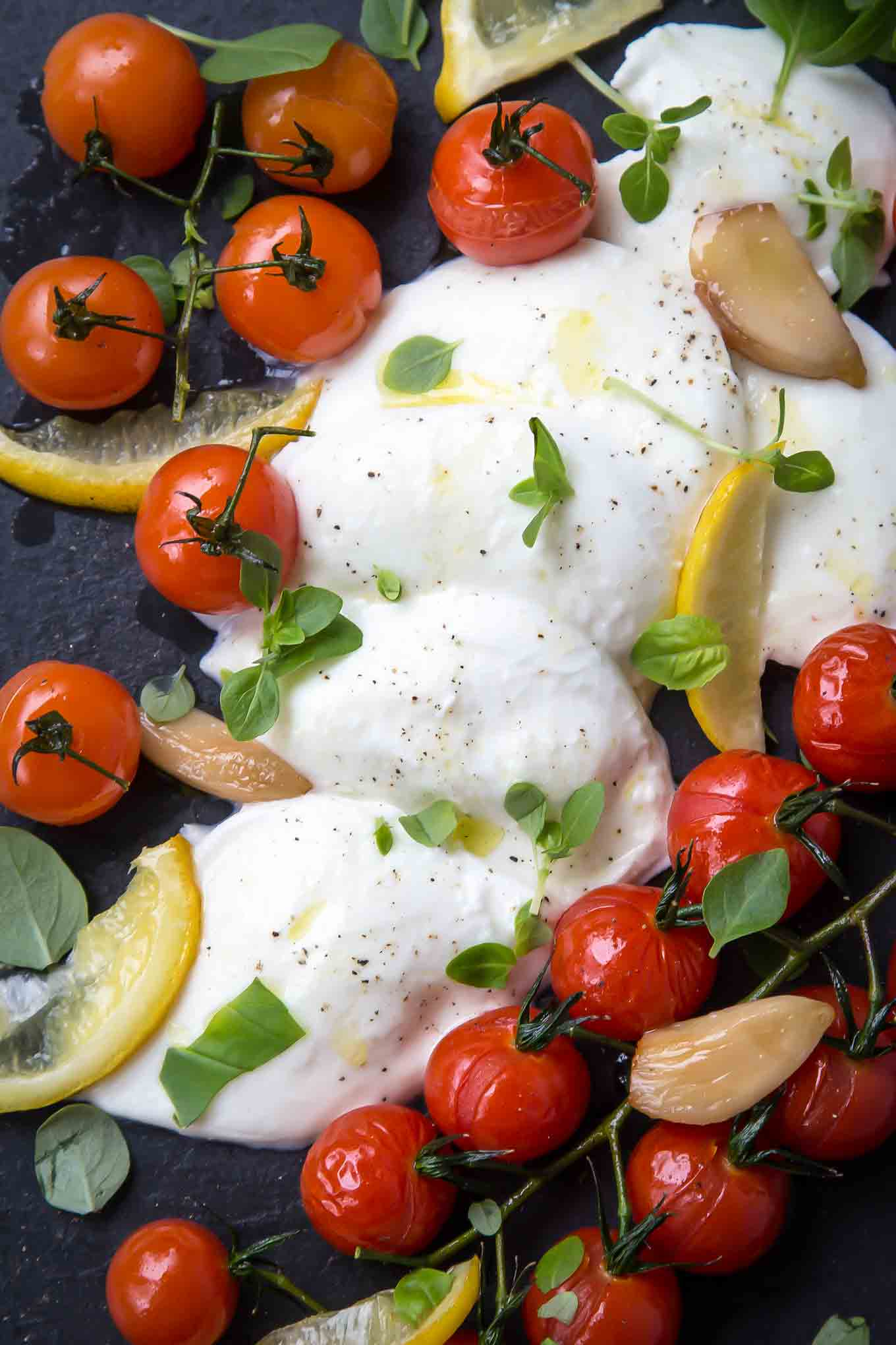 Baked Cherry Tomato, Mozzarella and Basil Salad with Confit Garlic is an alternative, elegant, winter take on the traditional caprese.