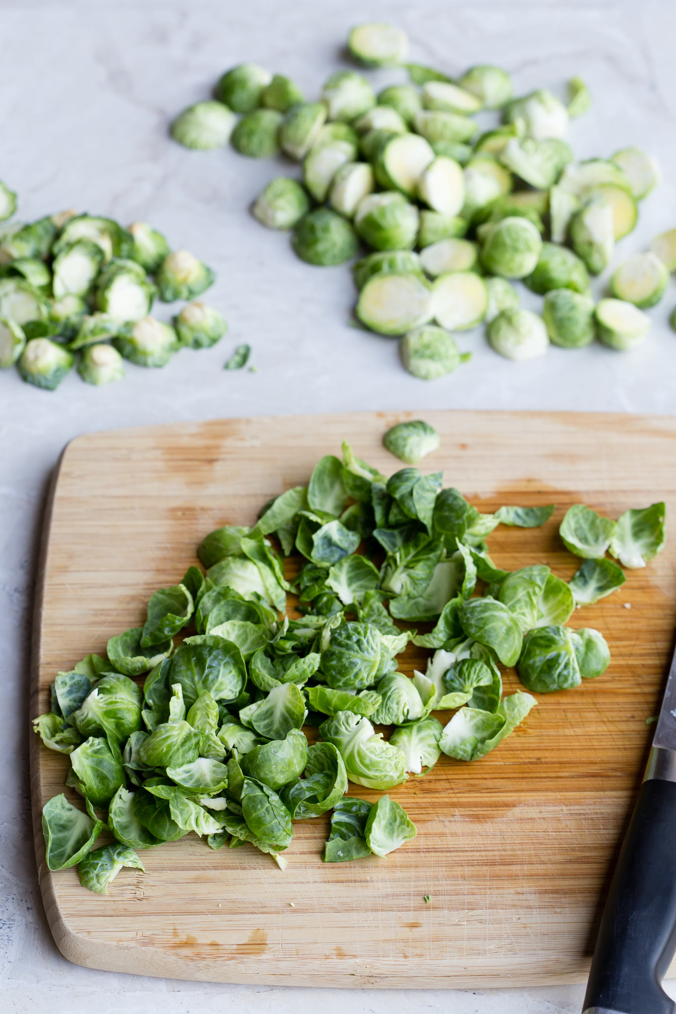 Trimmed Brussels sprouts on a chopping board