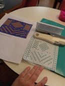 Punching holes to match my pattern design. This is pattern #1 - Guernsey inspired, but I chose #2 -fish!