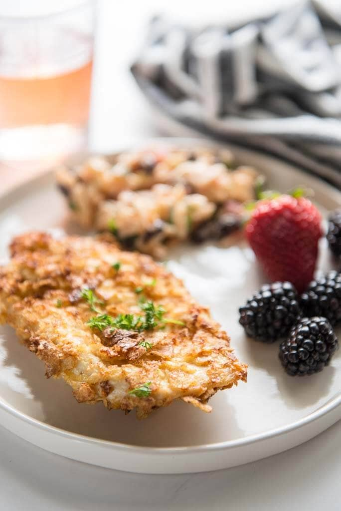 air fryer potato chip chicken on white plate with berries
