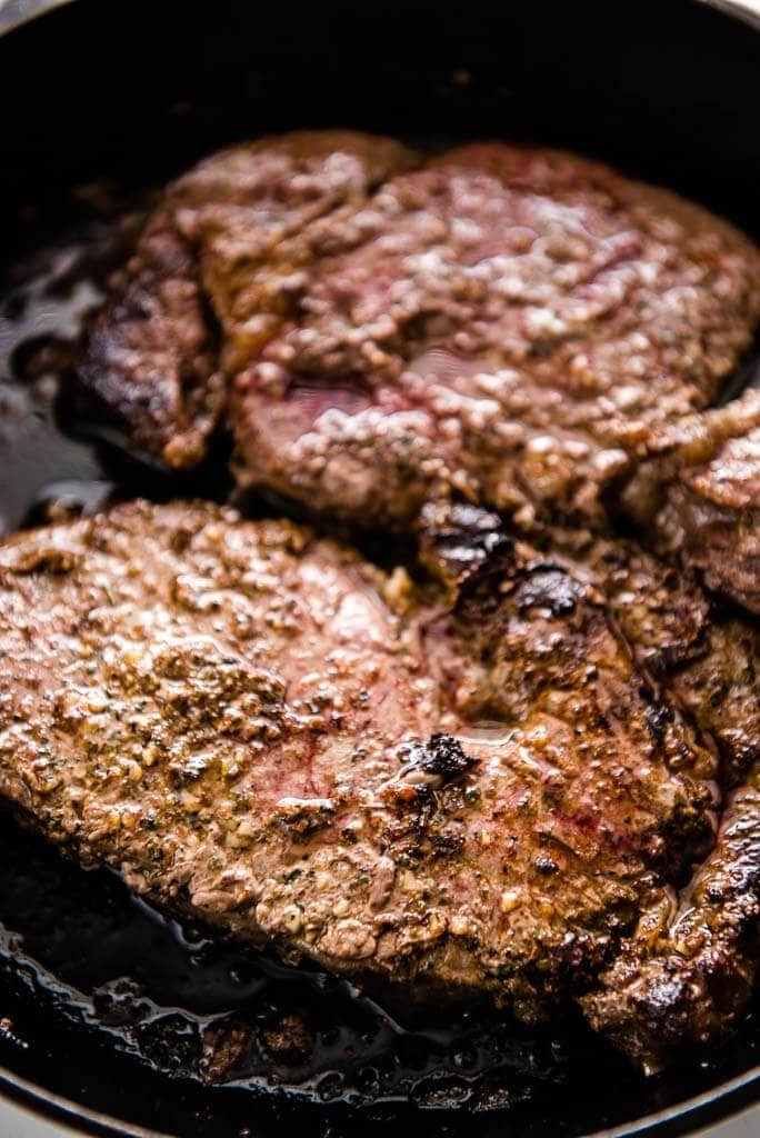 ribeye steak in cast iron skillet
