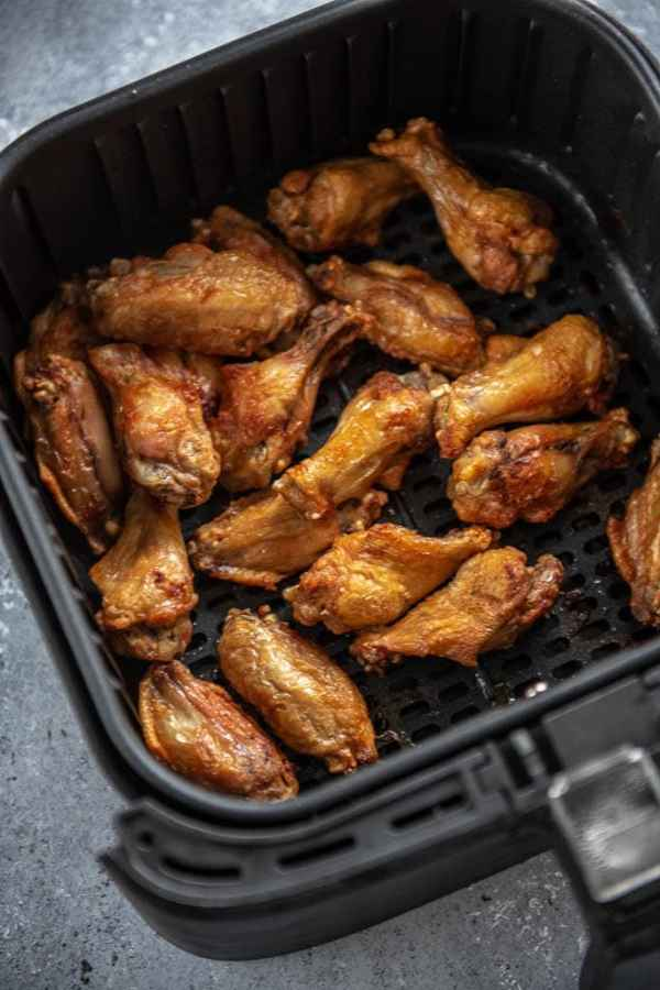cooked chicken wings in air fryer basket