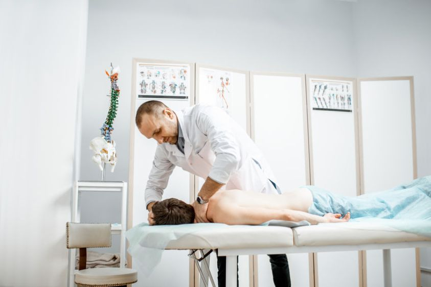 chiropractor doing manual treatment