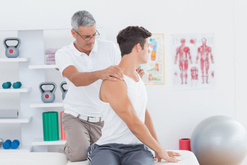 Doctor doing back adjustment in medical office
