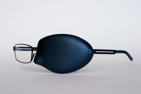 Bespoke glasses made for a man who lost an eye to cancer [carbon fibre, titanium frames]
