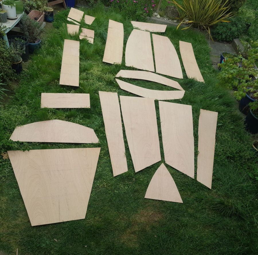 All the panels and pieces making up the hull, seats and buoyancy tanks laid out on the lawn.