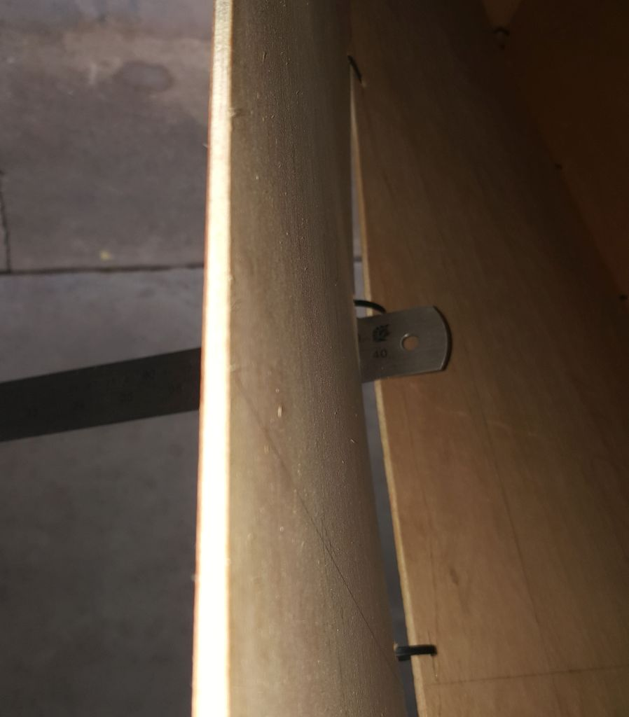 Aligning the panel edges with the aid of a steel ruler.