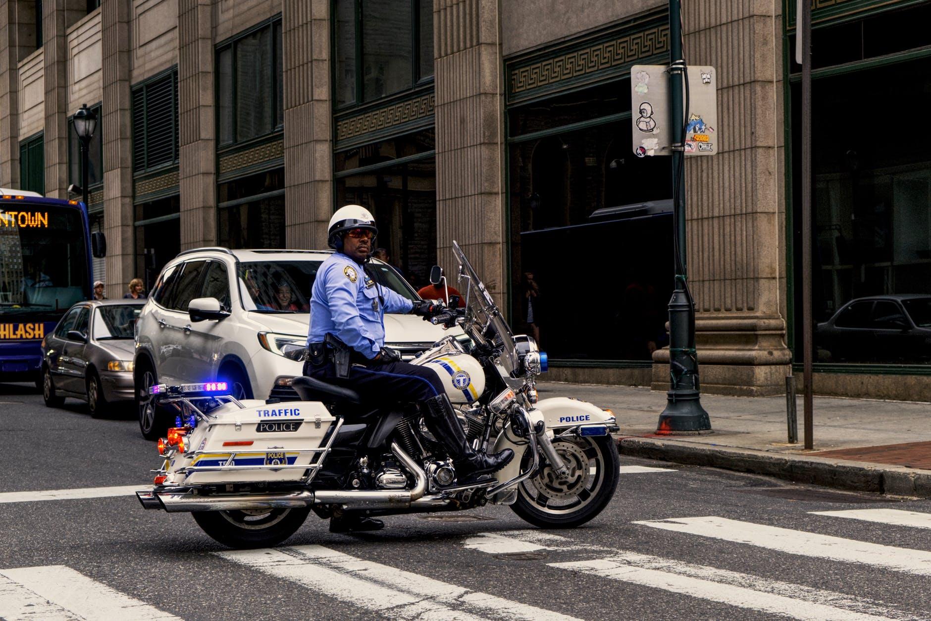 photo of man riding motorcycle
