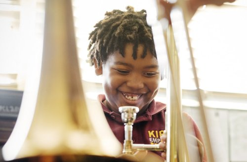 Amir Pinkney-Jengkens, 8, is learning trombone through Harmony Project, a nonprofit that provides musical instruments and instruction to children in low-income communities. Recent research suggests that such musical education may help improve kids' ability to process speech. (Annie Tritt for NPR)