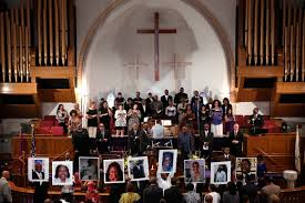 hotographs of the nine victims killed at the Emanuel African Methodist Episcopal Church in Charleston, S.C. are held up by congregants during a prayer. (ABC)