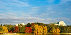 Balloon and Autumn trees on Lake Burley Griffin Bridge to Bridge Gary Lum