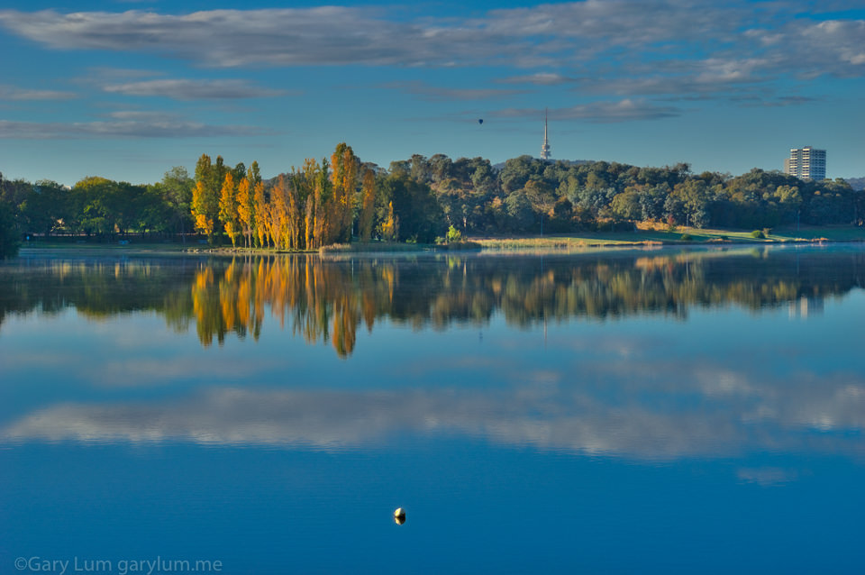 Telstra Tower and a balloon on Lake Ginninderra. HDR Processed. Reflections Gary Lum