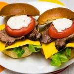 Beef brisket brioche burger with lettuce, tomato, smoked cheddar cheese and garlic aioli Gary Lum