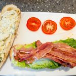 Preparing a white bread bâtard BLT with two kinds of cheese Gary Lum