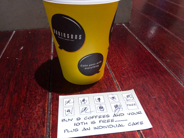 This is a photograph of the coffee I bought on Saturday with my Dobinsons coffee card showing the next coffee would be free and I'd also get a piece of cake.