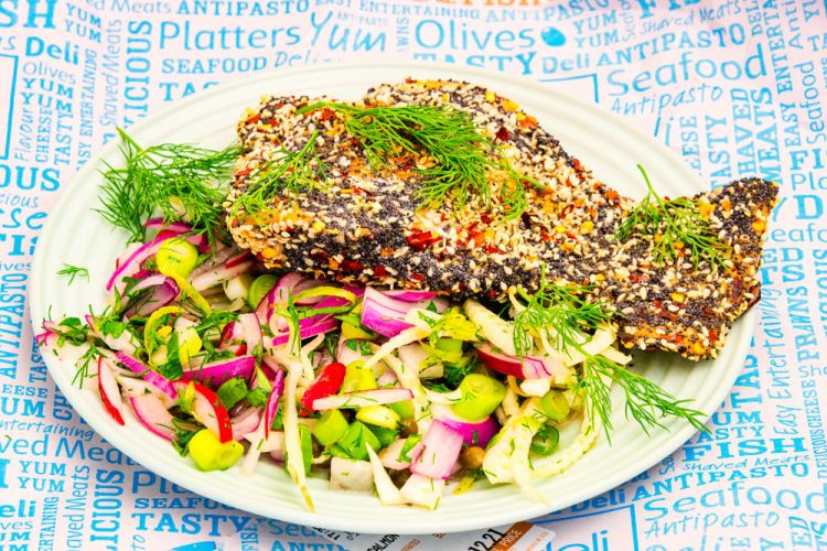 This is a photograph of Monday dinner. Baked poppy and sesame seed, chilli crusted salmon and lime flavoured fennel and radish salad. This is a really colourful photograph.