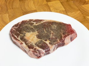 This is a photograph of Scotch fillet steak seasoned with salt, pepper and garlic powder.