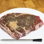 This is a photograph of Scotch fillet steak with the MEATER thermometer