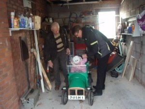 Dad and I load my daughter into the car he made.