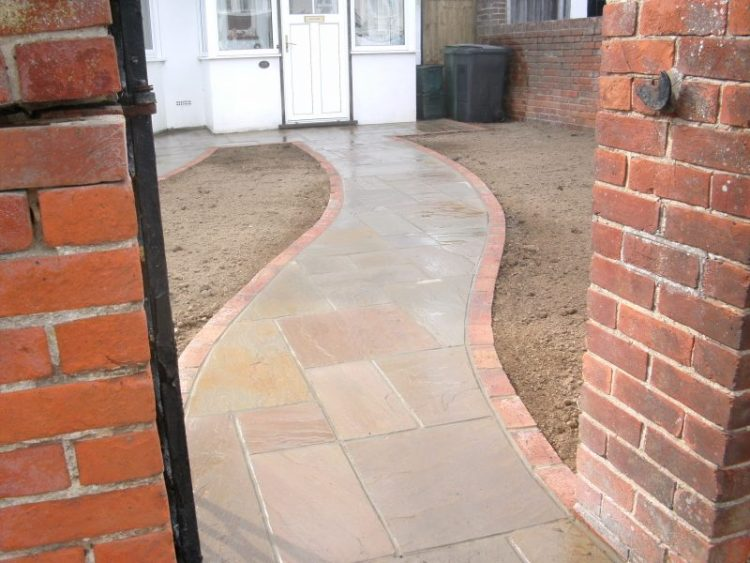 Indian Stone Path with Brick Edging by Gary Simes in East Sussex