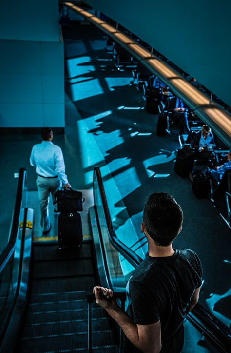 scene going down an airport escalator