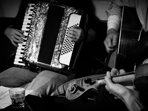 Hands and instruments at an Irish seisiún