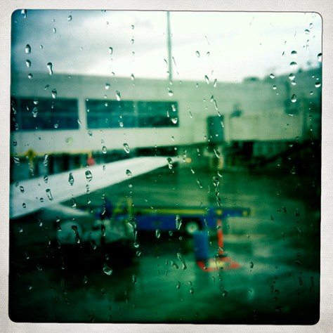 Through a rain splashed plane window before leaving the gate