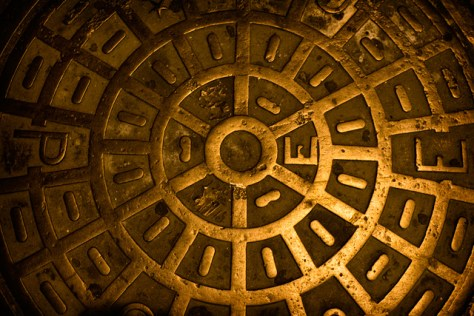 SF manhole cover at night