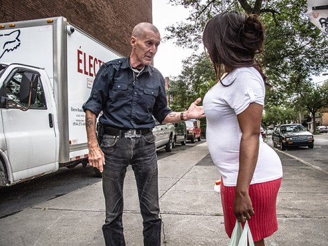 A man and a woman having a conversation on the street